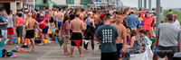 Runners gather to await swimmers leaving the water