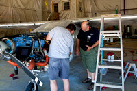 Kent checks with Jim who is painting Kent's plane